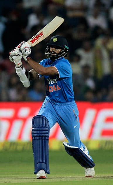 Shikhar Dhawan plays a stroke during the first T20 match between India and Sri Lanka in Pune.