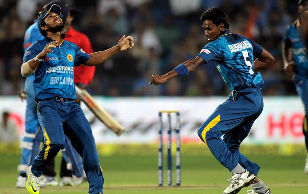 Sri Lanka cricket player Dushmantha Chameera, left celebrates during the first T20 match between India and Sri Lanka in Pune.