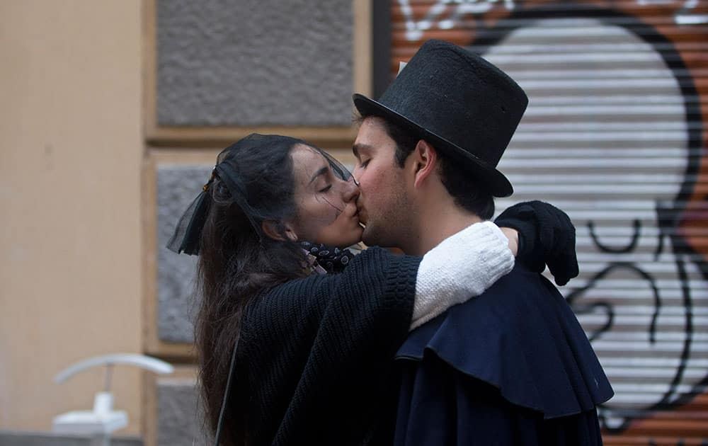 Members of the Alegre brotherhood kiss outside their headquarters in Madrid, Spain.