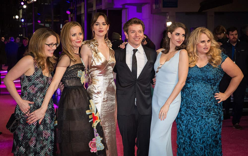 From left, producer Dana Fox, actresses Leslie Mann, Dakota Johnson, director Christian Ditter, actresses Alison Brie and Rebel Wilson pose for photographers upon arrival at the premiere of the film How To Be Single in London.
