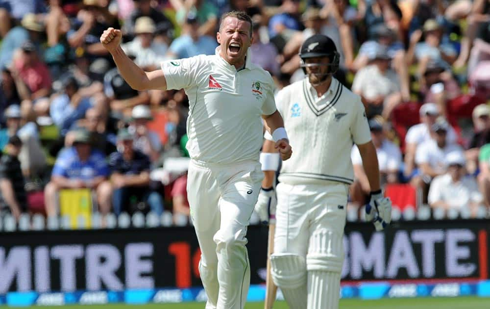 Australia's Peter Siddle captures the wicket of New Zealand's Henry Nichols for 8 on the first day of the first International Cricket Test match at Basin Reserve, Wellington, New Zealand.