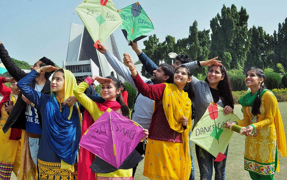 Girls dressed in yellow take part in kite flying on the occassion of Basant Panchami Festival at Punjab University in Patiala.