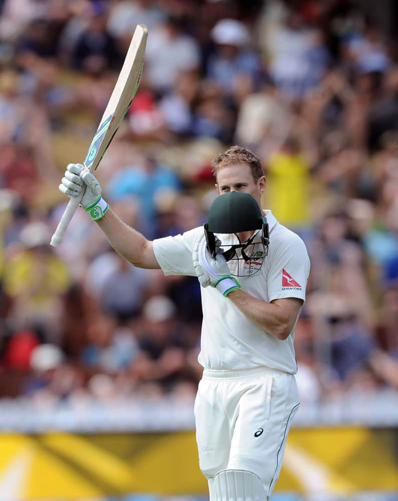 Australia's Adam Voges kisses his helmet after reaching against double century against New Zealand on the third day of the first International Cricket Test match at Basin Reserve, Wellington, New Zealand.