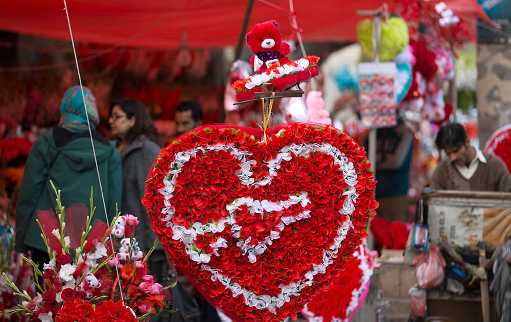 People buy flowers to celebrate the upcoming Valentine's Day in Islamabad, Pakistan.
