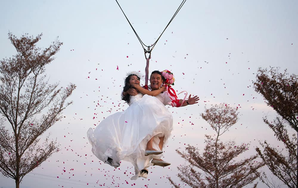 Bride Jintara Promachat and groom Kittinant Suwansiri celebrate Valentine's Day as they take to the skies in a