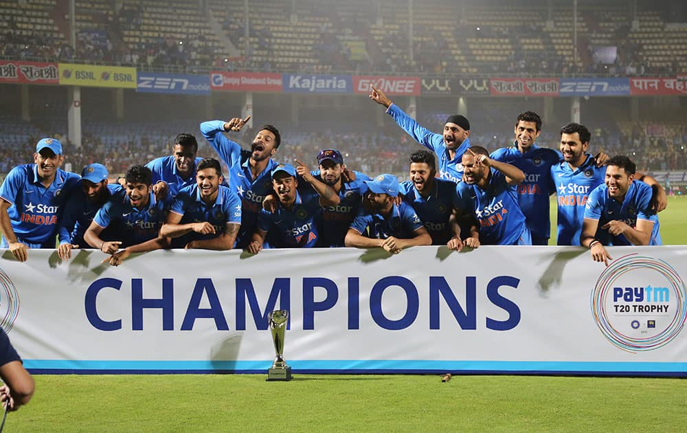 Members of the Indian cricket team celebrate with the winning trophy after their Twenty20 cricket series win against Sri Lanka, in Vishakapatnam.