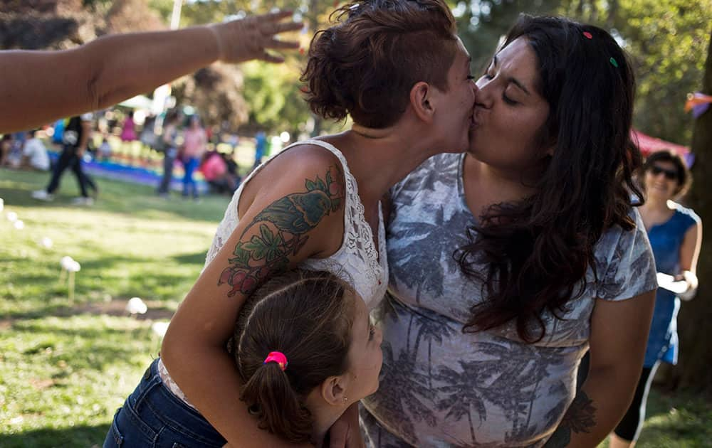 A couple kiss during a mock wedding as part of a Valentine's Day event, organized by the Homosexual Liberation and Integration Movement, in Santiago, Chile.