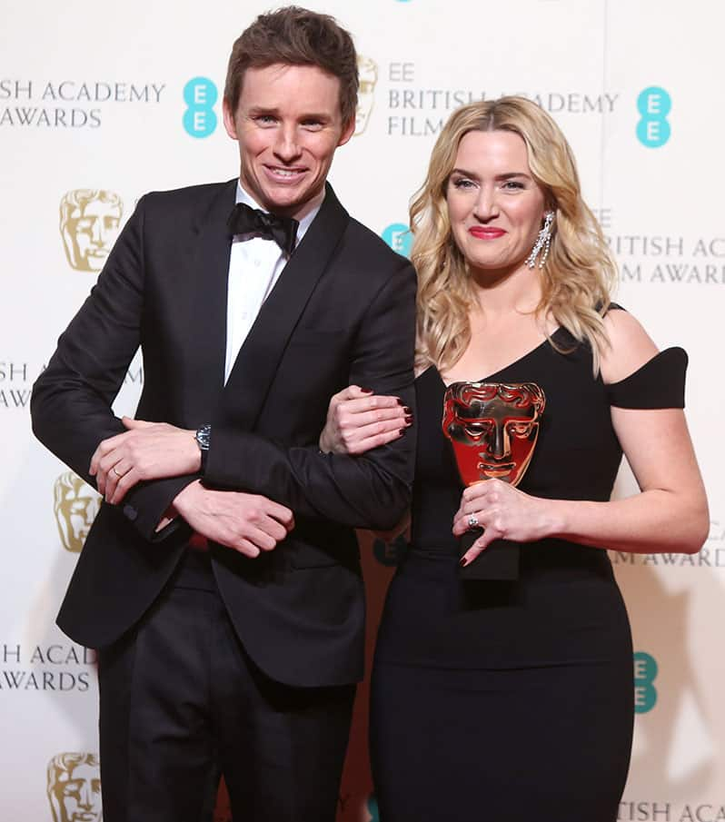 Actor Eddie Redmayne poses with actress Kate Winslet who won the award for Best Supporting Actress in the film 'Jobs' backstage at the BAFTA 2016 film awards at the Royal Opera House in London.