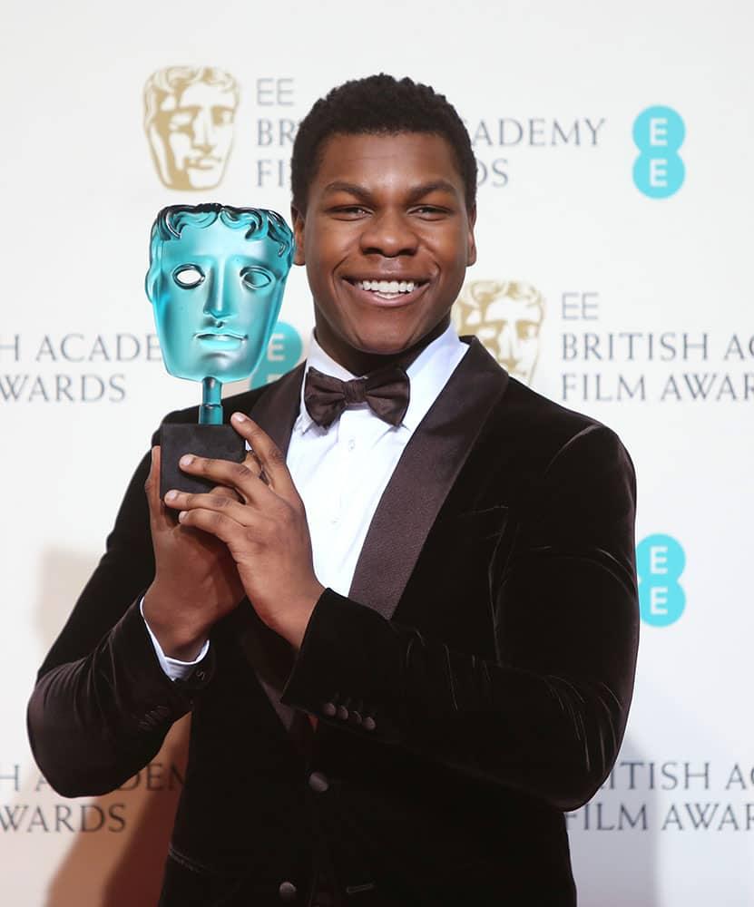 Rising Star winner John Boyega poses for photographers backstage at the BAFTA 2016 film awards at the Royal Opera House in London.