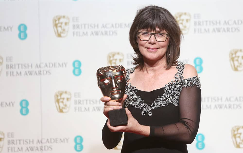 Magaret Sixel with her award for Editing for the film 'Mad Max' poses for photographers backstage at the BAFTA 2016 film awards at the Royal Opera House in London.