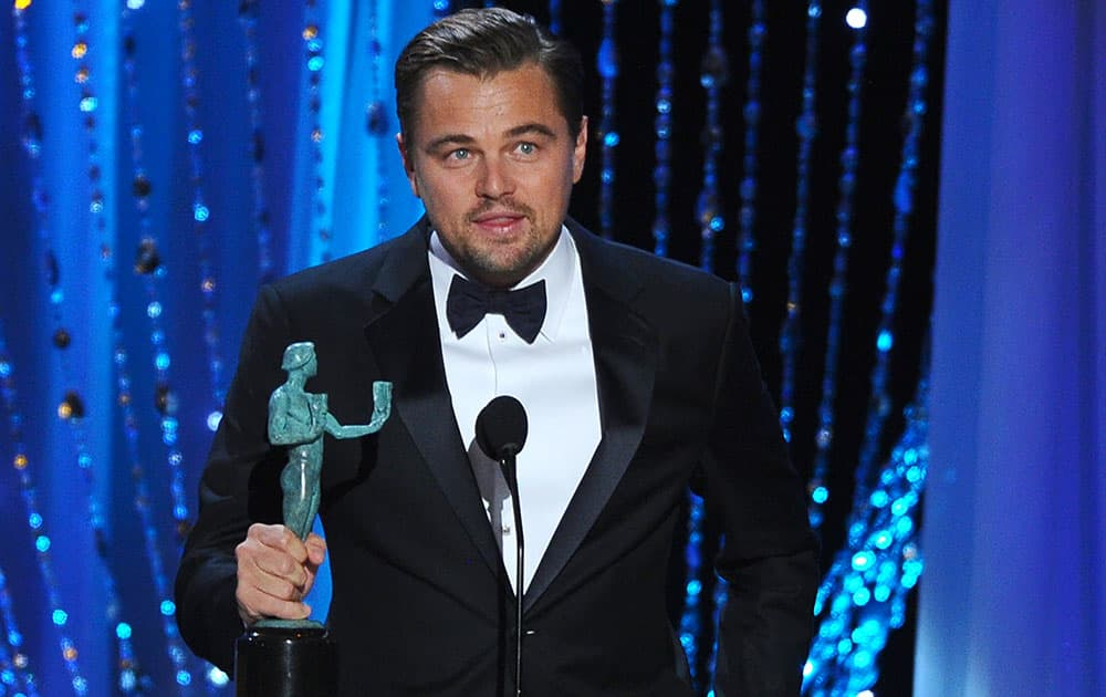 """Leonardo DiCaprio accepts the award for outstanding male actor in a leading role for """"The Revenant"""" at the 22nd annual Screen Actors Guild Awards at the Shrine Auditorium & Expo Hall."""