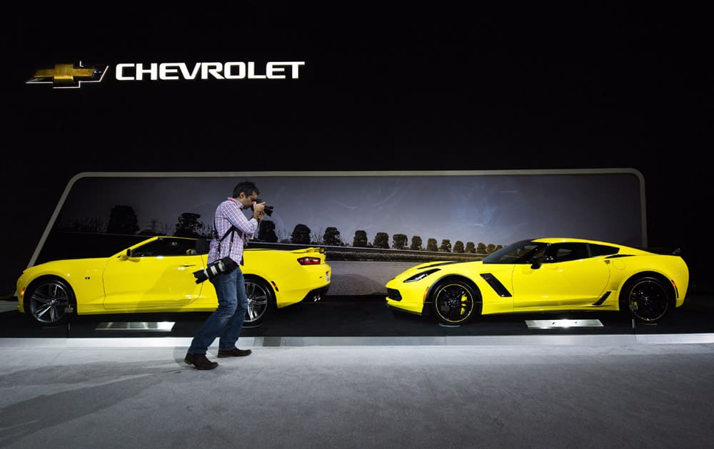 A man photographs a Chevy Corvette at the 2016 Canadian International Autoshowin Toronto on Thursday, Feb. 11, 2016.