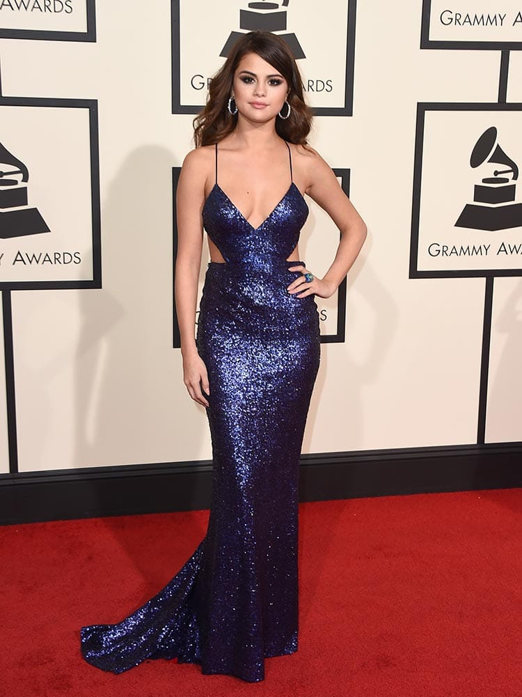 Selena Gomez arrives at the 58th annual Grammy Awards at the Staples Center, in Los Angeles.
