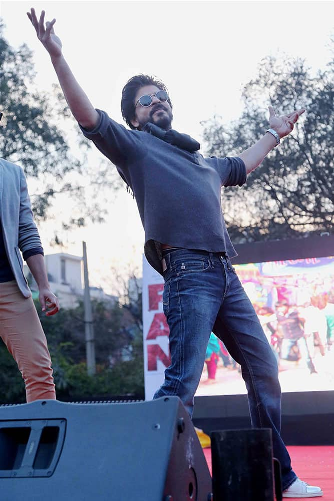 Actor Shahrukh Khan strikes a pose at the launch of his new film song at Hansraj College in New Delhi.