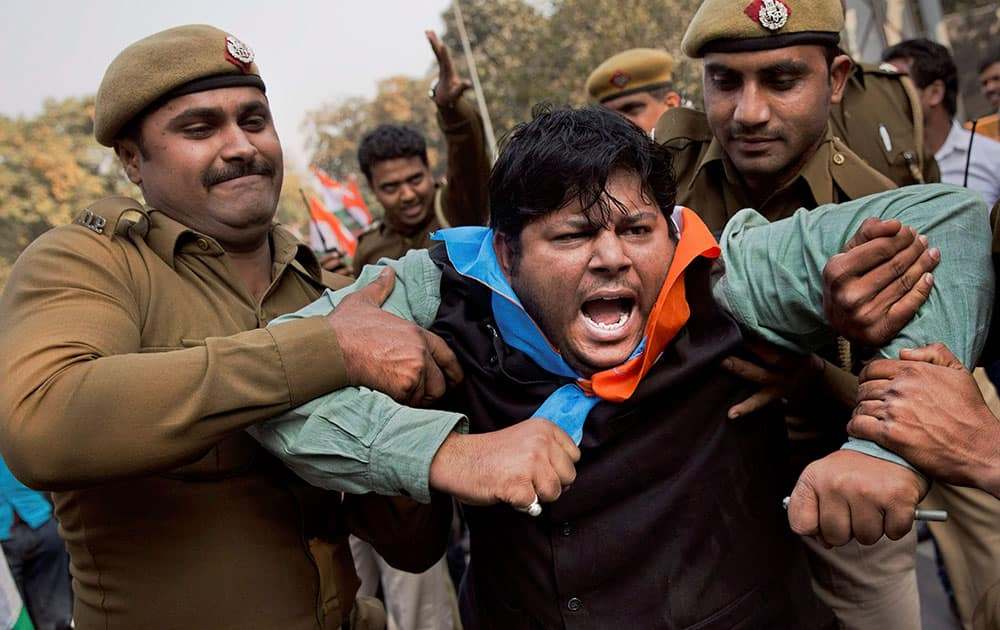 A member of National Students Union of India is detained by police during a protest in support of JNUSU President Kanhaiya Kumar, in New Delhi.