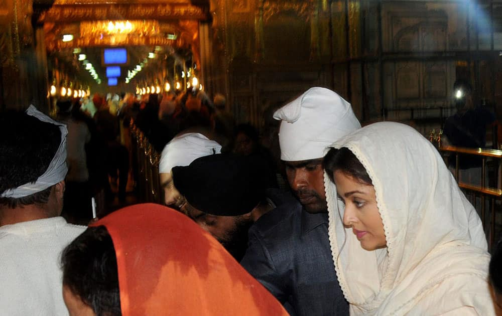 Bollywood actress Aishwarya Rai Bachchan gestures during a visit to the Golden temple in Amritsar.