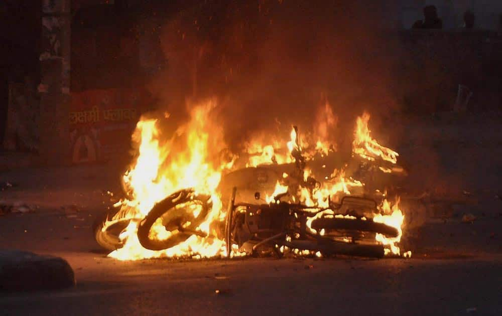Jat community members torch motorcyles during their agitation for reservation in Rohtak.