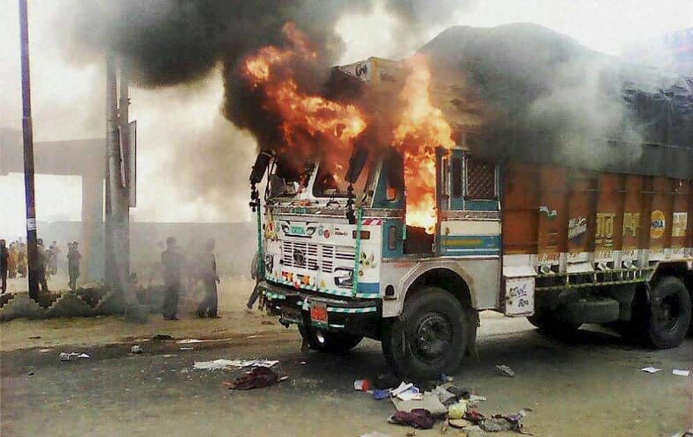 Irate mob torch a truck after it mowed down three school girls in Sambhal.