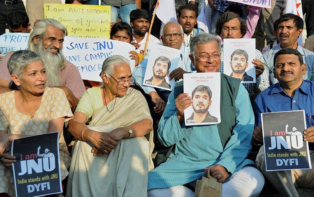 Playwright Girish Karnad with members of DYFI protesting against the arrest of JNU students leader Kanhaiya Kumar in Bengaluru.