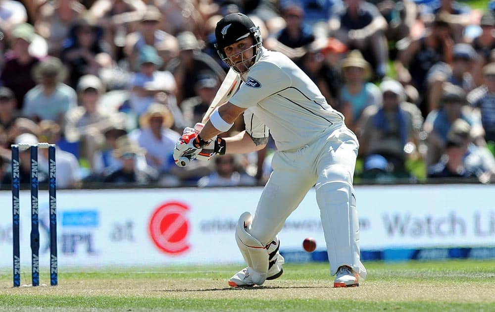 New Zealand's Brendon McCullum comes down the wicket to Australia's Mitchell Marsh's bowling on the first day of the second International Cricket Test match at Hagley Park Oval in Christchurch, New Zealand.