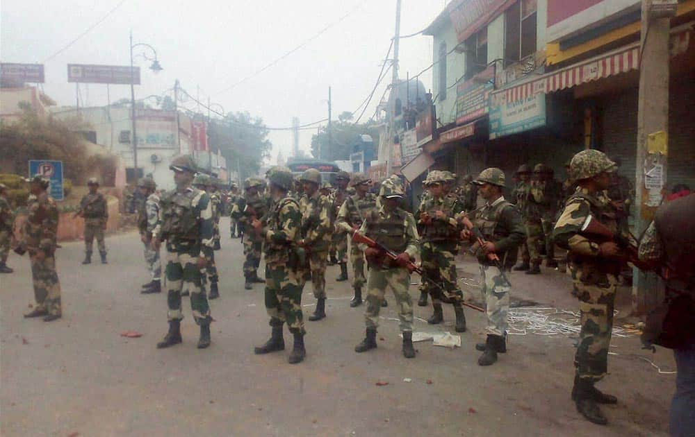 Security forces personnel patrol in the view of incidents of violence due to Jat agitation for reservation, in Rohtak.