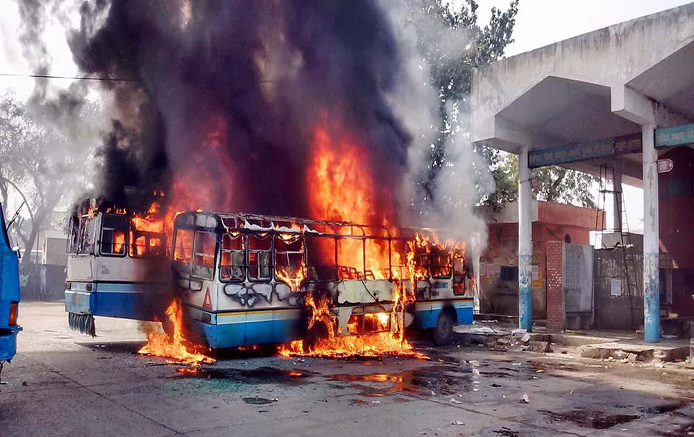 Buses set on fire as the Jat agitation for reservation intensifies in Sonipat.