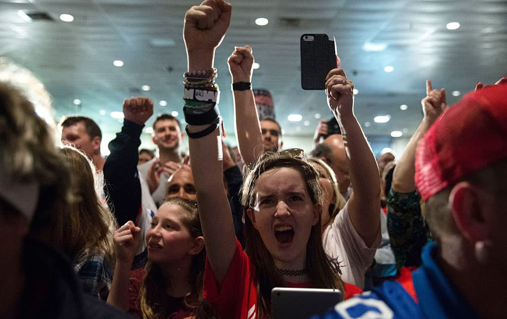 Members of the crowd cheer before Republican presidential candidate, Sen. Ted Cruz, R-Texas, appears for his South Carolina primary night rally at the South Carolina State Fairgrounds in Columbia, S.C.