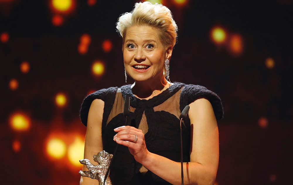 Actress Trine Dyrholm addresses the audience after winning the silver bear award, during the award ceremony at the 2016 Berlinale Film Festival in Berlin.