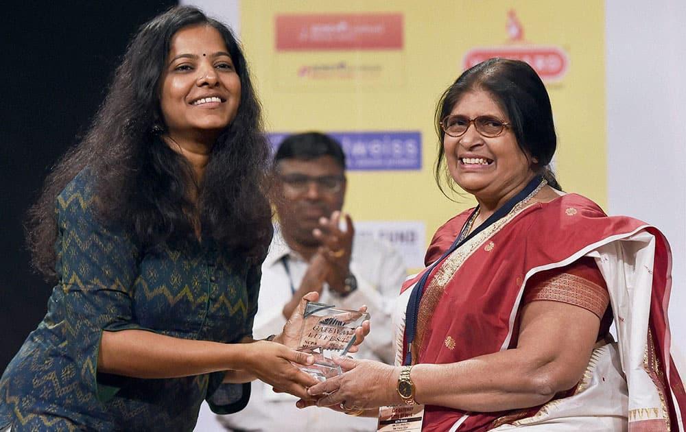 Tamil Filmmaker, Poet and actor, Leena Manimekalai (L) felicitates Sahitya Academy award winner and writer Shefalika Verma at the LIC Gateway Litfest 2016 literature festival, in Mumbai.