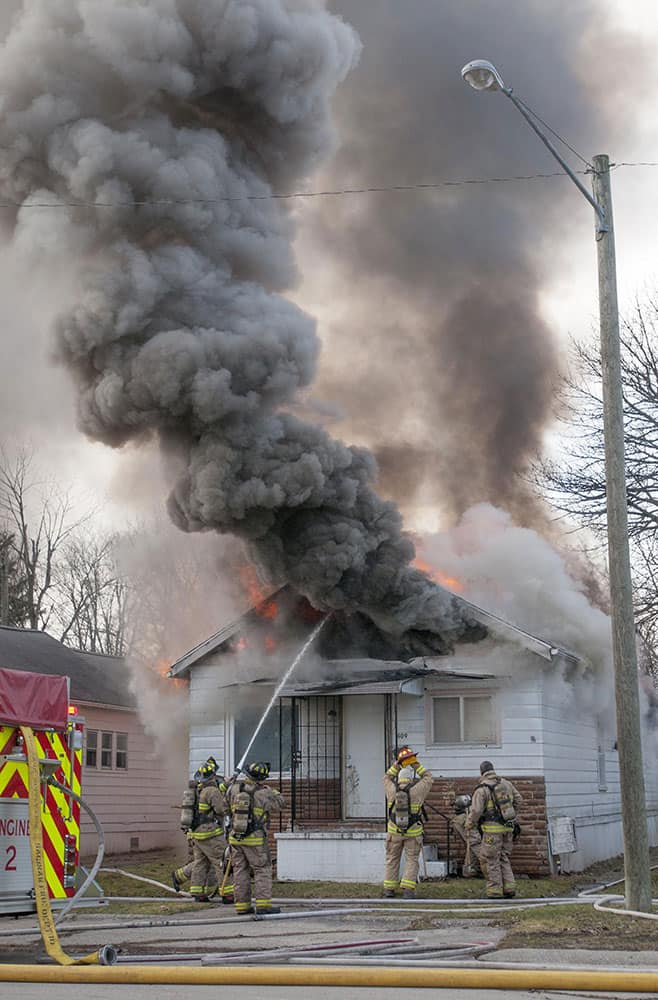 Saginaw : Firefighters work to extinguish a fire.