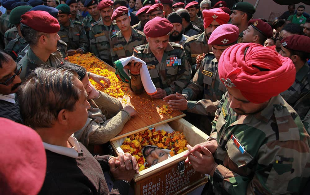 Soldiers surround the coffin of Indian Army Captain Tushar Mahajan before perform his last rites in Udhampur.