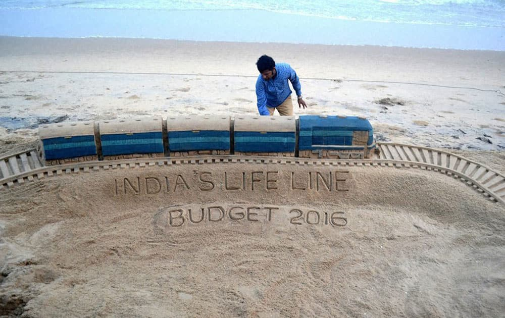 Sand artist Sudarsan Pattnaik created a sculpture on on Rail budget 2016 with message Indias life line at Puri beach of Odisha.