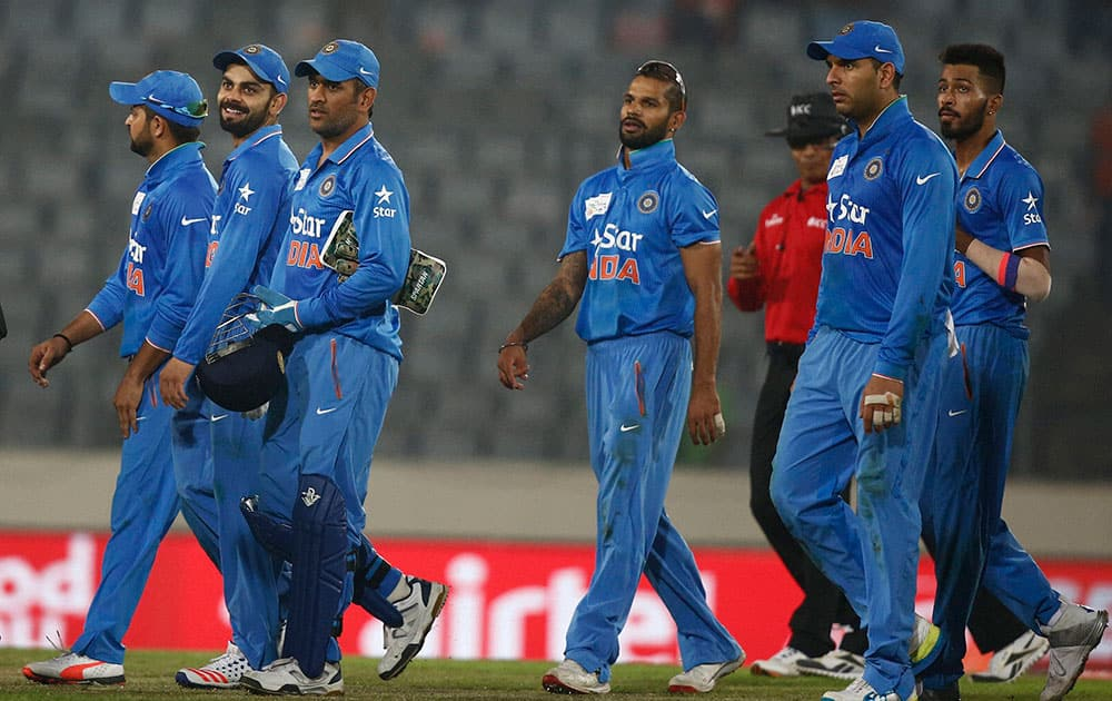 India's cricket players walk out from the field after winning against Bangladesh during the Asia Cup Twenty20 international cricket match in Dhaka, Bangladesh.