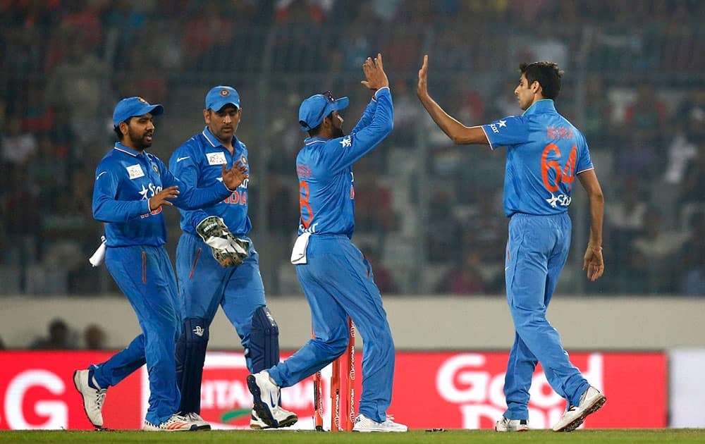India's Ashish Nehra, right, celebrates with his teammates after the dismissal of Bangladesh's Md Mithunduring the Asia Cup Twenty20 international cricket match against Bangladesh in Dhaka, Bangladesh.