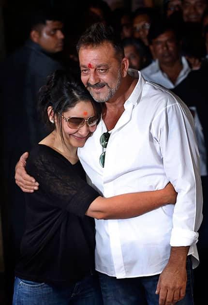 Sanjay Dutt hugs his wife Maanyata after arriving at his residence in Mumbai.
