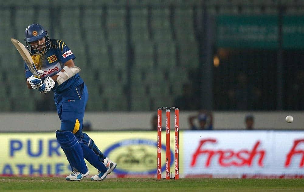 Sri Lankan cricketer Tillakaratne Dilshan plays a shot during the Asia Cup Twenty20 international cricket match against United Arab Emirates in Dhaka.