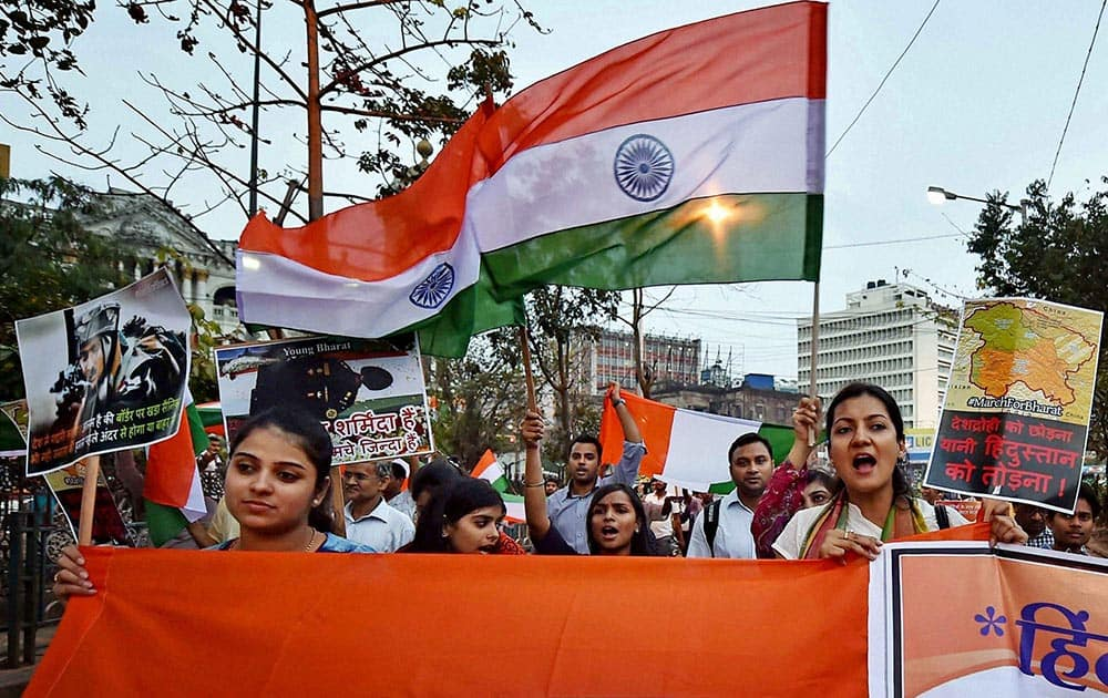 Activists participate in March for Bharat with the Nation Flag to stop anti-national activities, in Kolkata.