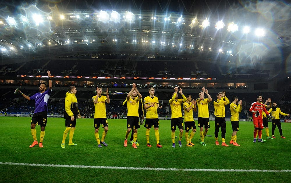 Dortmund players celebrate at the end of a Europa League round of 32, second leg, soccer match between FC Porto and Borussia Dortmund at the Dragao stadium in Porto, Portugal