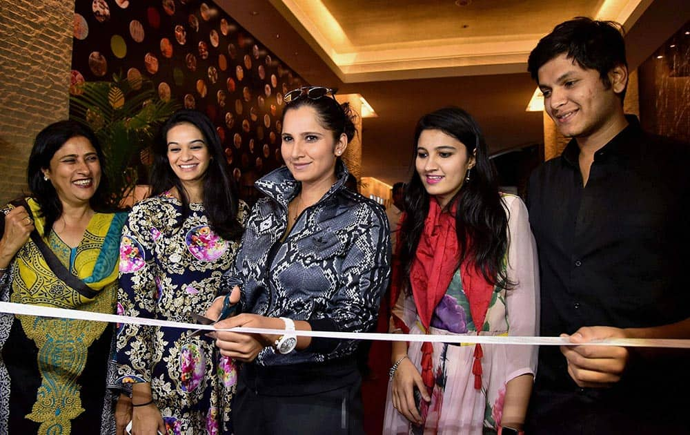 Tennis star Sania Mirza inaugurates an exhibtion of designer clothes in Hyderabad.