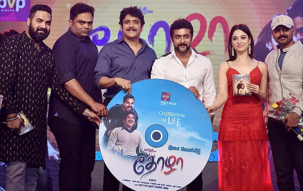 Actors Akkineni Nagarjuna, Karthi, Suriya, Tamannaah and others during the audio launch of their upcoming movie Thozha in Chennai.