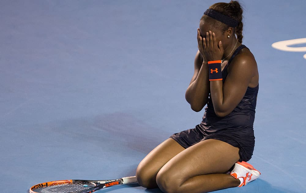 Sloane Stephens, of the United States, covers her face after defeating Dominika Cibulkova, of Slovakia, during the WTA final of the Mexican Tennis Open in Acapulco, Mexico.