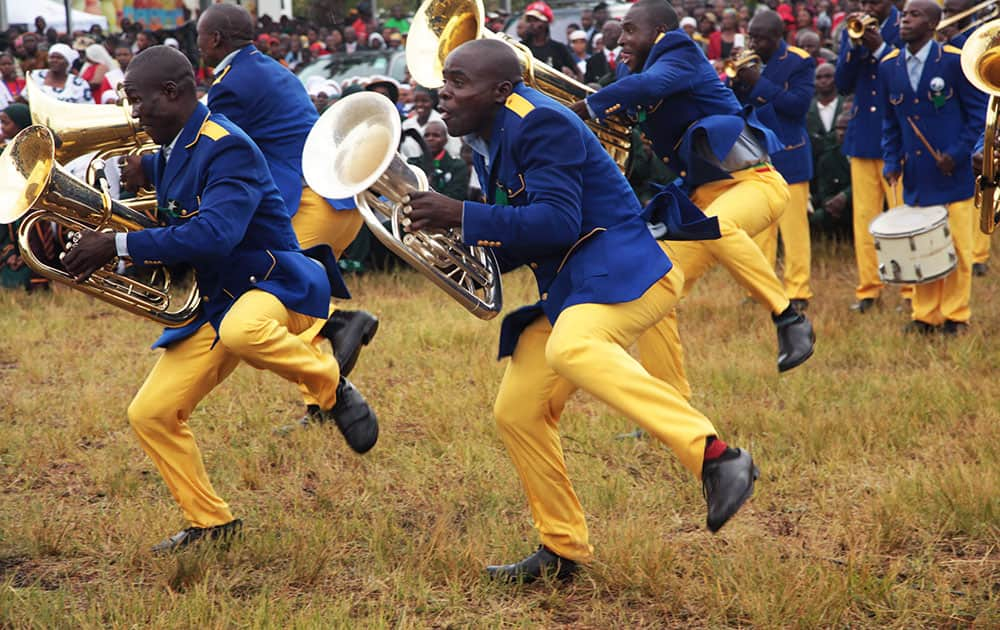 Members of a band perform during celebrations to mark Zimbabwean President Robert Mugabe's 92nd Birthday celebrations in Masvingo about 300 kilometres south of Harare.