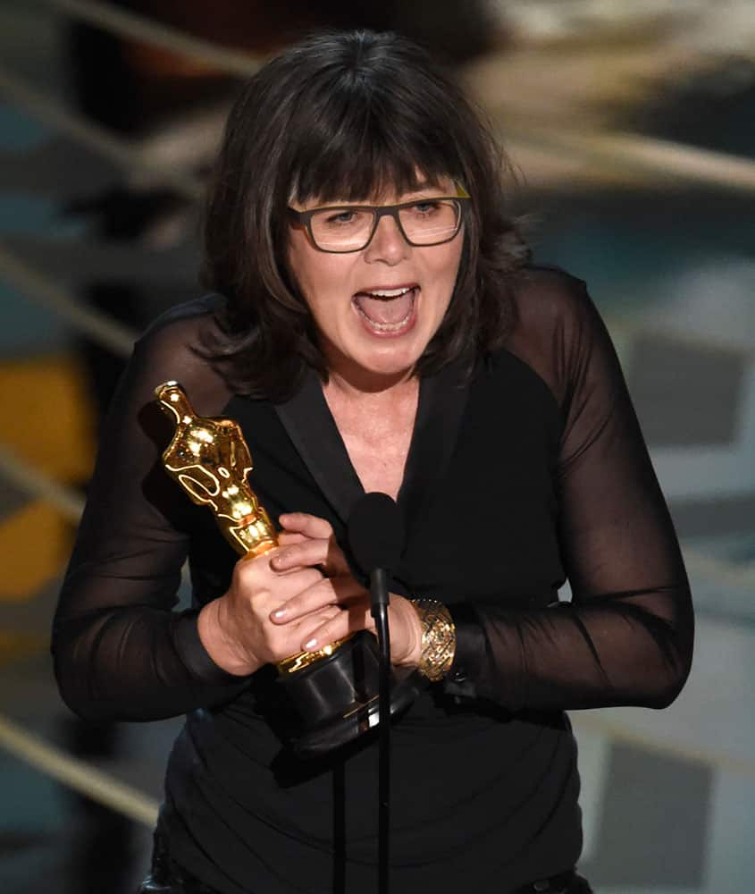 """Margaret Sixel accepts the award for best film editing for """"Mad Max: Fury Road"""" at the Oscars."""