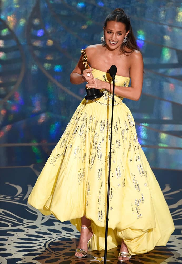 """Alicia Vikander accepts the award for best actress in a supporting role for """"The Danish Girl"""" at the Oscars."""