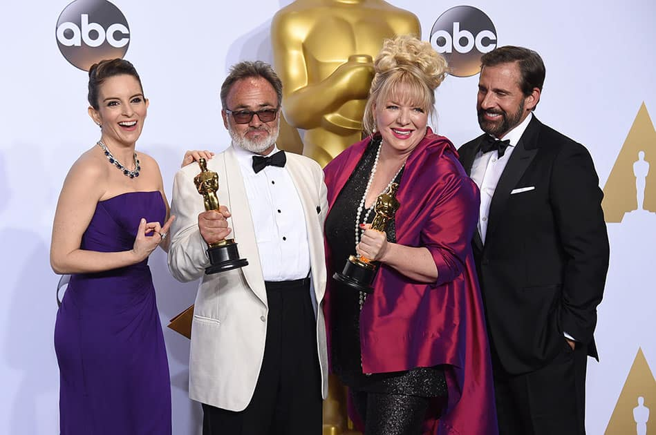 """Tina Fey, left, and Steve Carell, right, pose in the press room with Colin Gibson, second left, and Lisa Thompson, winners of the award for best production design for """"Mad Max: Fury Road"""", at the Oscars at the Dolby Theatre in Los Angeles."""
