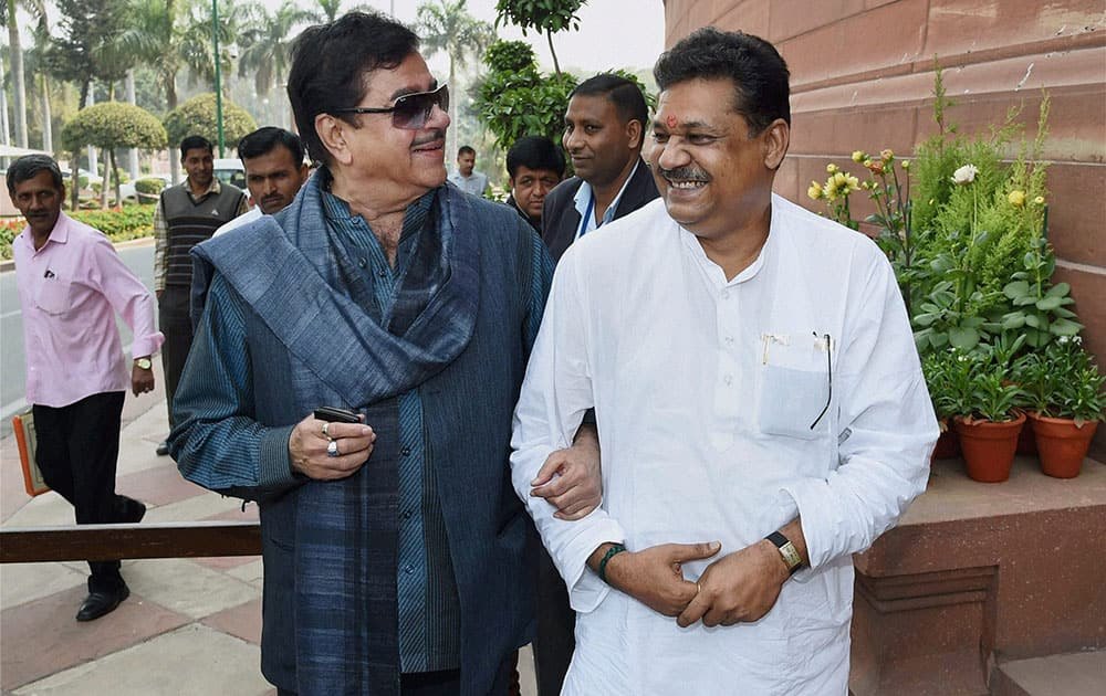 BJP MPs Shatrughan Sinha and Kirti Azad outside Parliament during the budget session.
