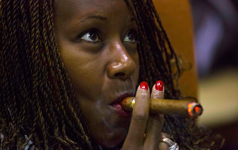 Cigar enthusiast Luann Parker from the U.S. smokes on the opening day of the annual Havana Cigar Festival in Havana, Cuba.