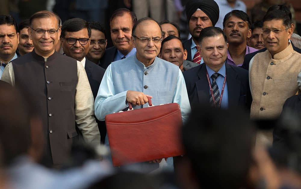 Indian Finance Minister Arun Jaitley, center, leaves for annual budget presentation at parliament in New Delhi, India.