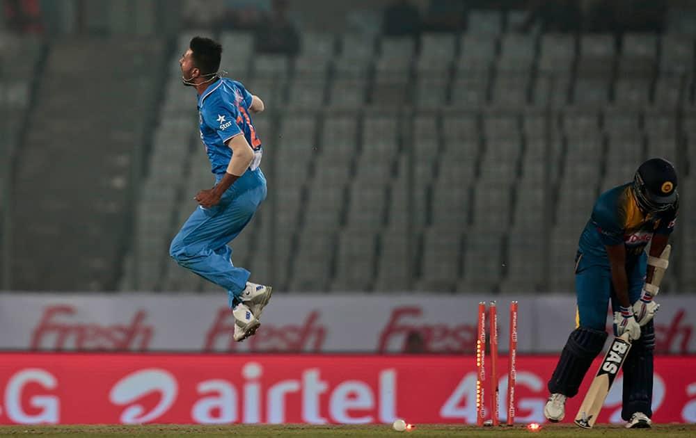 Hardik Pandya reacts after claiming the wicket of Sri Lanka's captain Angelo Mathews during their Asia Cup Twenty20 international cricket match in Dhaka, Bangladesh.