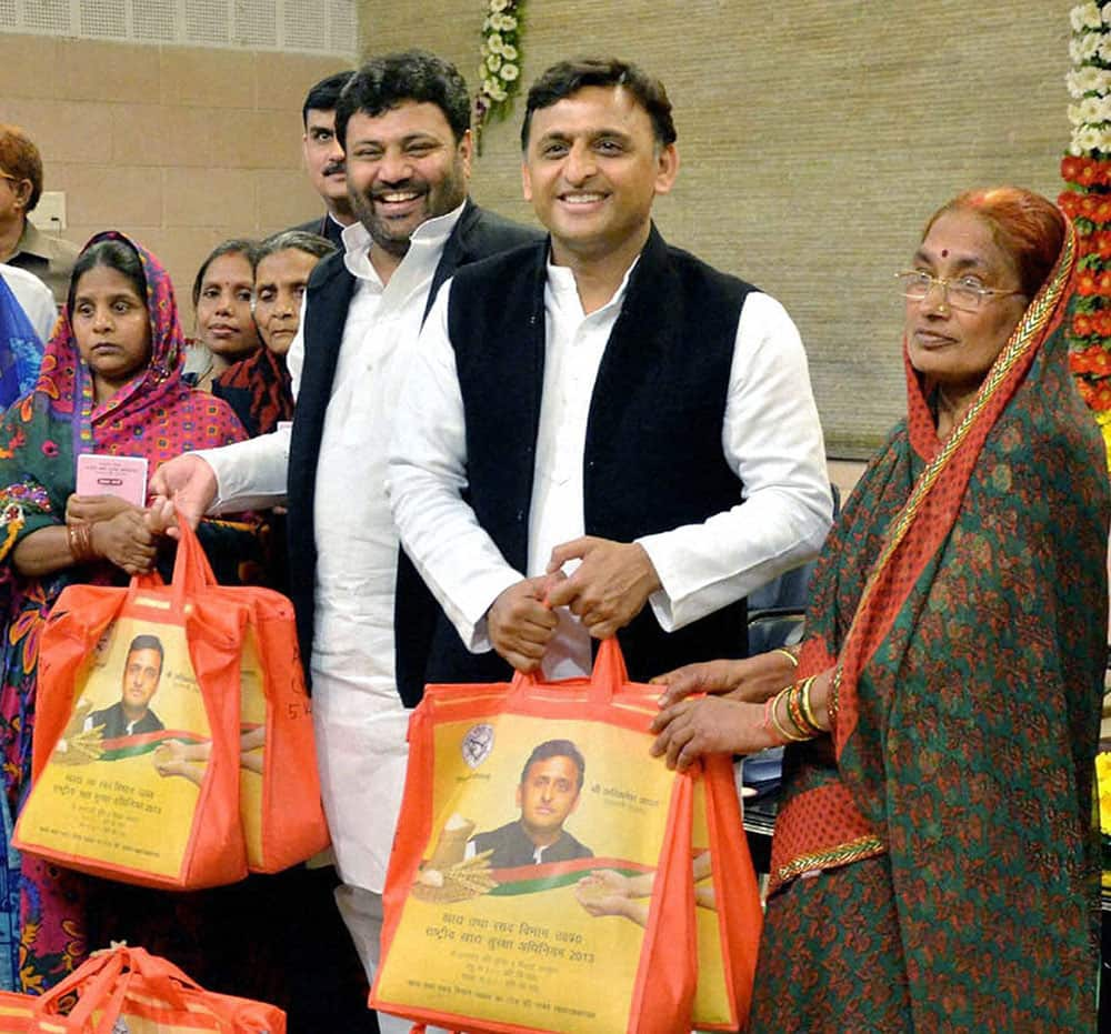 Uttar Pradesh Chief Minister Akhilesh Yadav with the beneficiary women during the launch of National Food Security Act, in Lucknow.